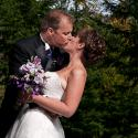 Kinsmen Gorge park; bride; couple; garden; Gorge waterway; groom; kiss; outside;